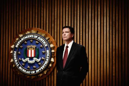 Director James B. Comey speaks during an F.B.I. press conference at the J. Edgar Hoover Building in Washington, D.C. on Monday, June 23, 2014.
