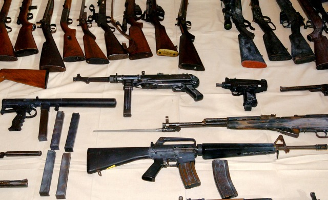 Melbourne, July 22, 2004. A range of firearms siezed following raids in Victoria by Commonwealth and State law enforcement agancies are displayed at the Australian Federal Police today. The firearms include a replica Owen submachine gun (centre at left) an MP-40 (centre) an uzi (centre right) as well as semi-automatic rifles. (AAP Image/Julian Smith) NO ARCHIVING