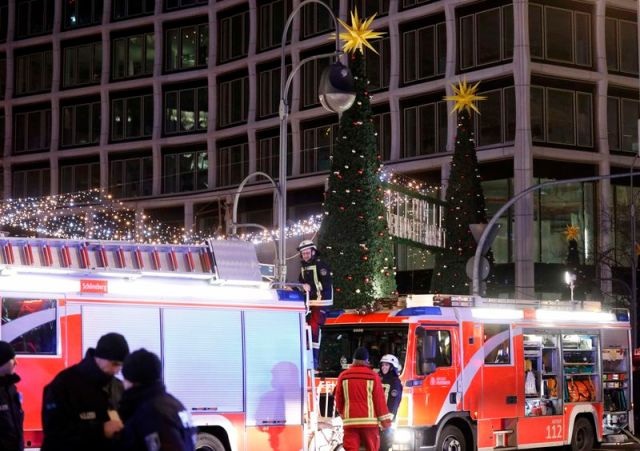 A fire engine is parked outside a Christmas market in Berlin, Germany, December 19, 2016 after a truck ploughed into the crowded Christmas market in the German capital. REUTERS/Pawel Kopczynski