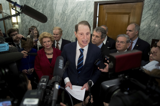 Sen. Ron Wyden, D-Ore., ranking member of the Senate Finance Committee, center, accompanied by, from left, Sen. Debbie Stabenow, D-Mich., Sen. Bill Nelson, D-Fla., Sen. Sherrod Brown, D-Ohio, Sen. Robert Menendez, D-N.Y. and Sen. Bob Casey, D-Pa., speaks in the hallway on Capitol Hill in Washington, Tuesday, Jan. 31, 2017, to discuss opposition to Human Services Secretary-designate, Rep. Tom Price, R-Ga. (AP Photo/Andrew Harnik)