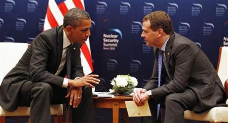 U.S. President Barack Obama (L) talks with Russian President Dmitry Medvedev in a bilateral meeting before attending the 2012 Nuclear Security Summit in Seoul March 26, 2012. REUTERS/Larry Downing