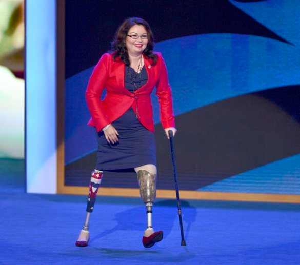 epa03383694 Tammy Duckworth, Candidate for the US House of Representatives walks off stage after her speech to the Democratic National Convention at the Time Warner Cable Arena in Charlotte, North Carolina, USA, 04 September 2012. Duckworth was a helicopter pilot who lost both her legs in combat injuries in Iraq. US President Barack Obama will be nominated to run for a second term at the convention. EPA/TANNEN MAURY
